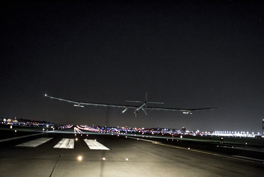The Solar Impulse - the first solar plane to be able to fly night and day - descending onto the runway at Lambert - St. Louis.