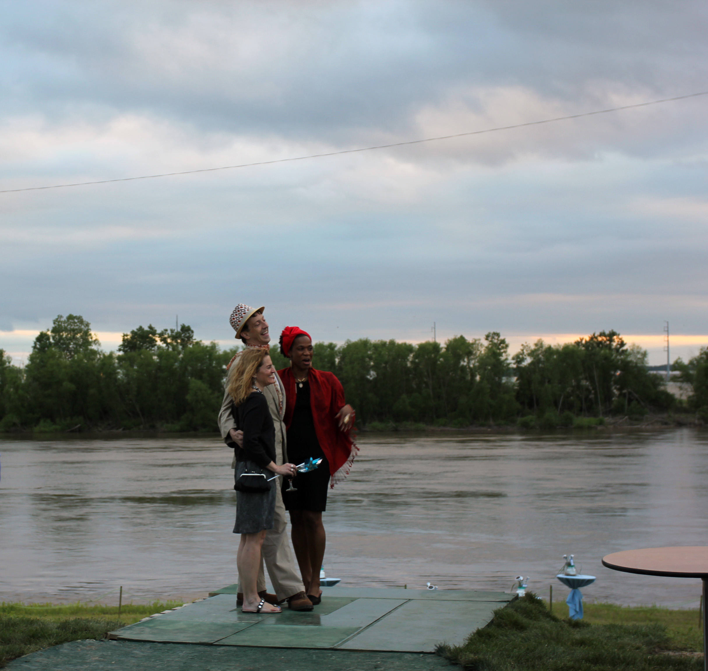 Guests at Bridging the Gap's Party at the Pumphouse get their photo taken in front of a Missouri River vista.