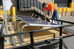 laying panels on horace mobile solar energy demo unit