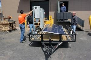 checking inverters on horace mobile solar energy demo unit