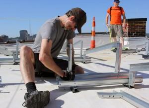 solar designer aaron moran puts together panel racking