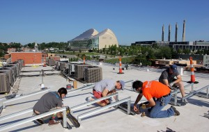 brighterg team puts together and bolts down racking for solar installation on kansas city hq