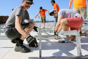 brightergy team builds solar power installation at office