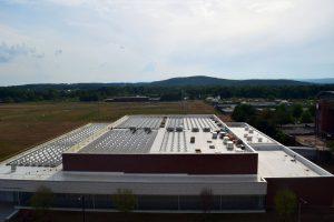 solar energy installation in progress at UMass Amherst Champions Center