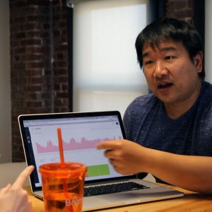 Bruce Wang leads a stand-up meeting with Brightergy R&D team